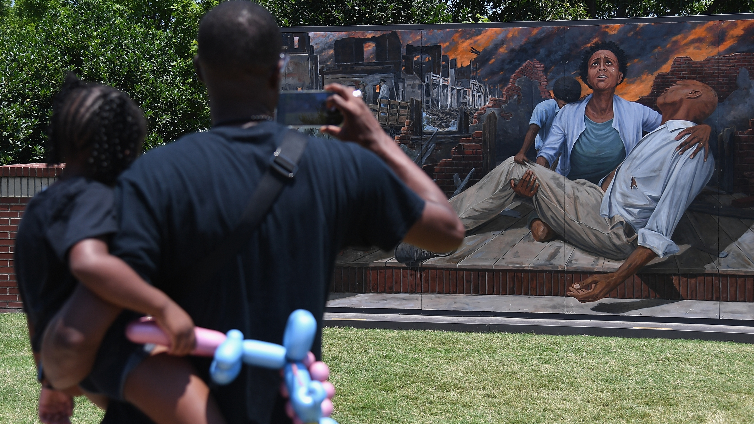 Attendees take in an art installation on Greenwood Avenue during the Juneteenth Festival on June 19, 2021 in Tulsa, Oklahoma. (Michael B. Thomas/Getty Images)