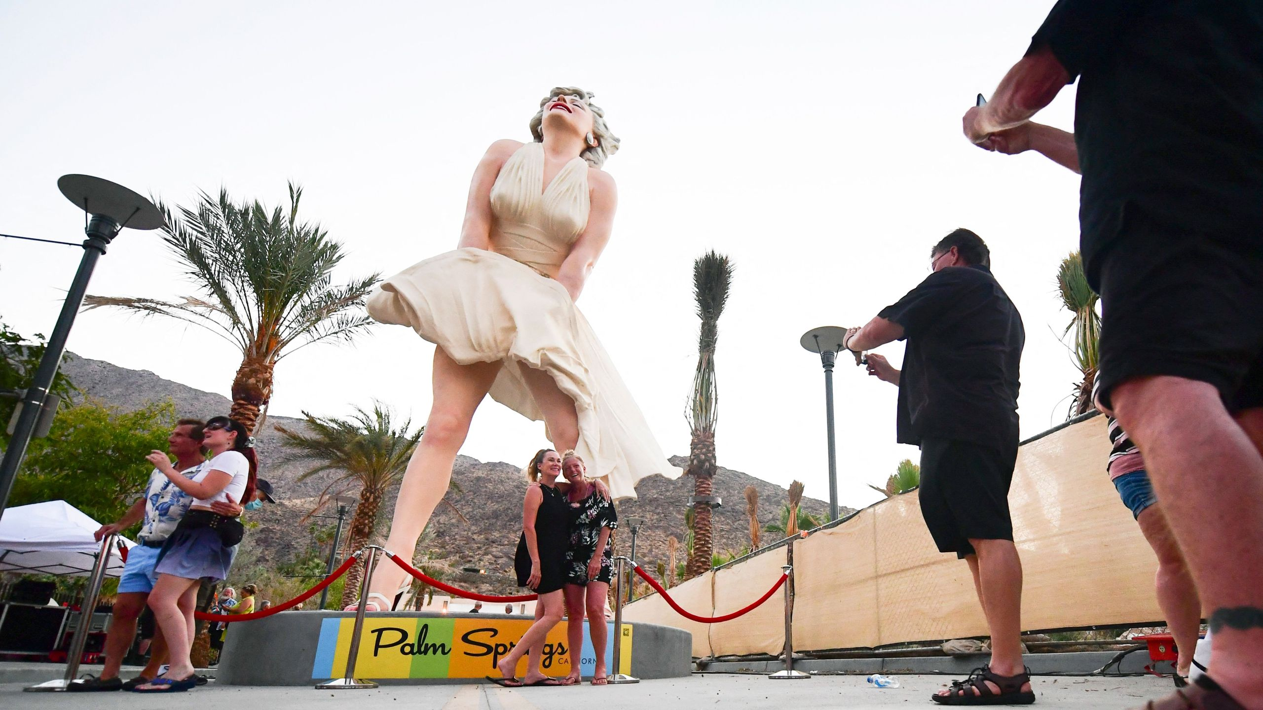 People visit the Forever Marilyn statue on its return to Palm Springs on June 20. Three days later, Palm Springs had rainfall — the city's first recorded rainfall on June 23 since 1922.(Frederic J. Brown / AFP / Getty Images)
