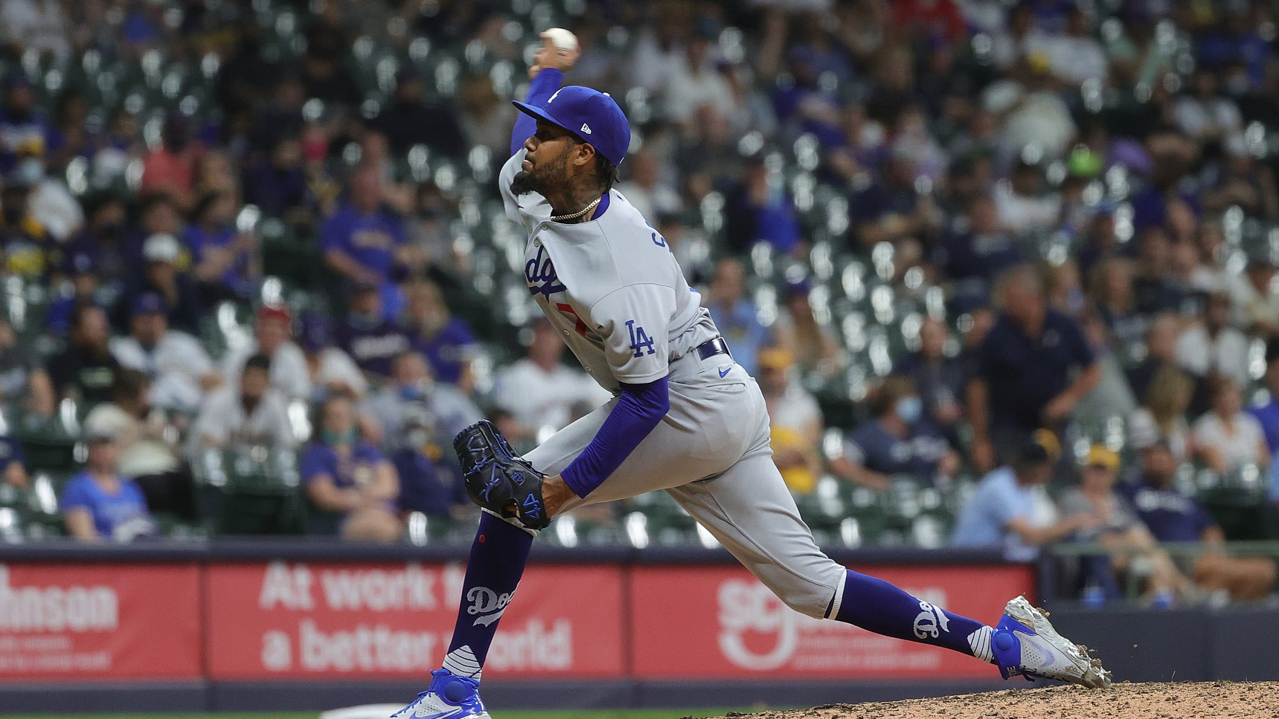 Dennis Santana of the Los Angeles Dodgers throws a pitch during the sixth inning against the Milwaukee Brewers at American Family Field on May 1, 2021 in Milwaukee. (Stacy Revere/Getty Images)