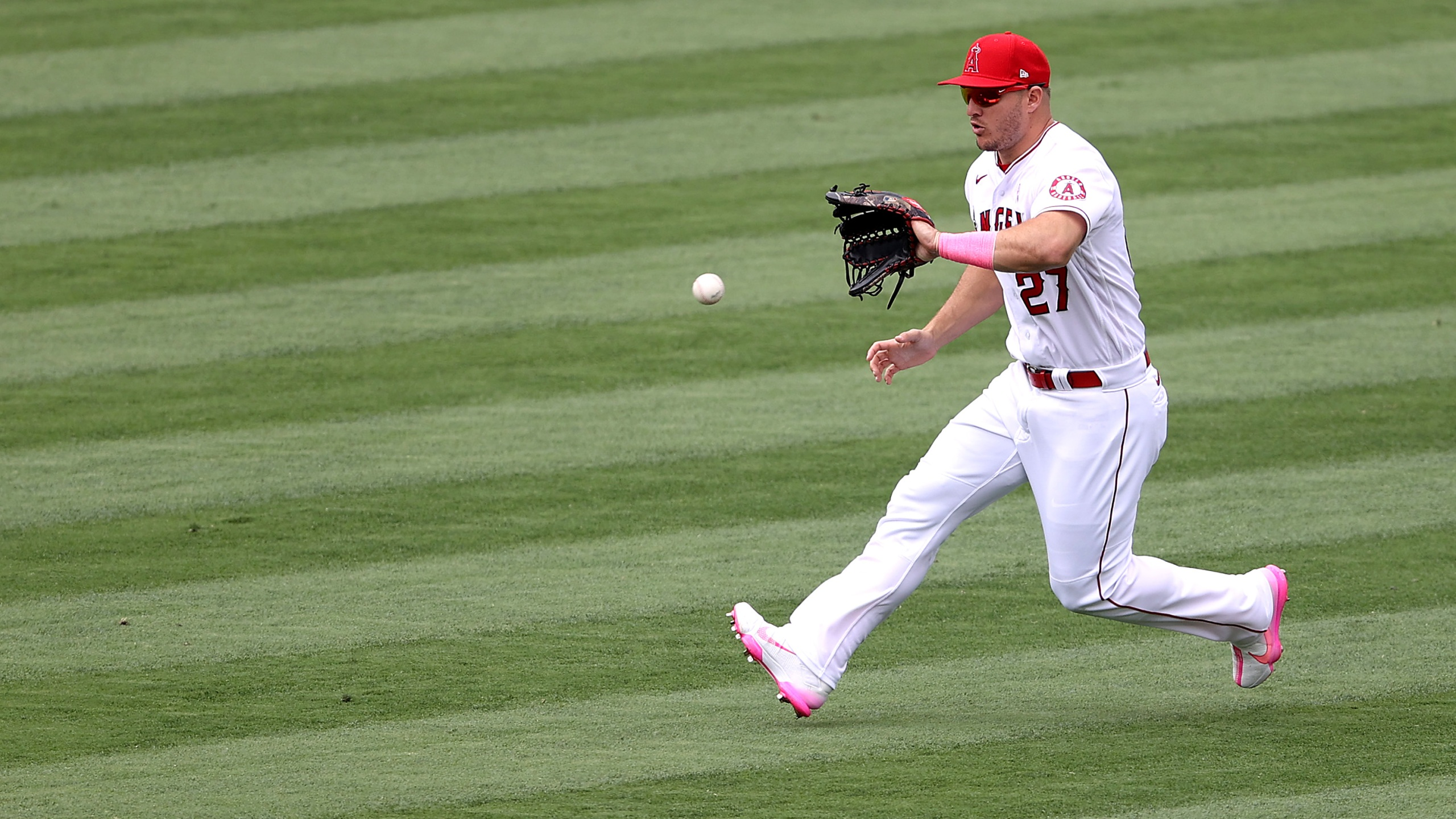 Mike Trout #27 of the Los Angeles Angels fields a fly ball on May 9, 2021. (Photo by Sean M. Haffey/Getty Images)