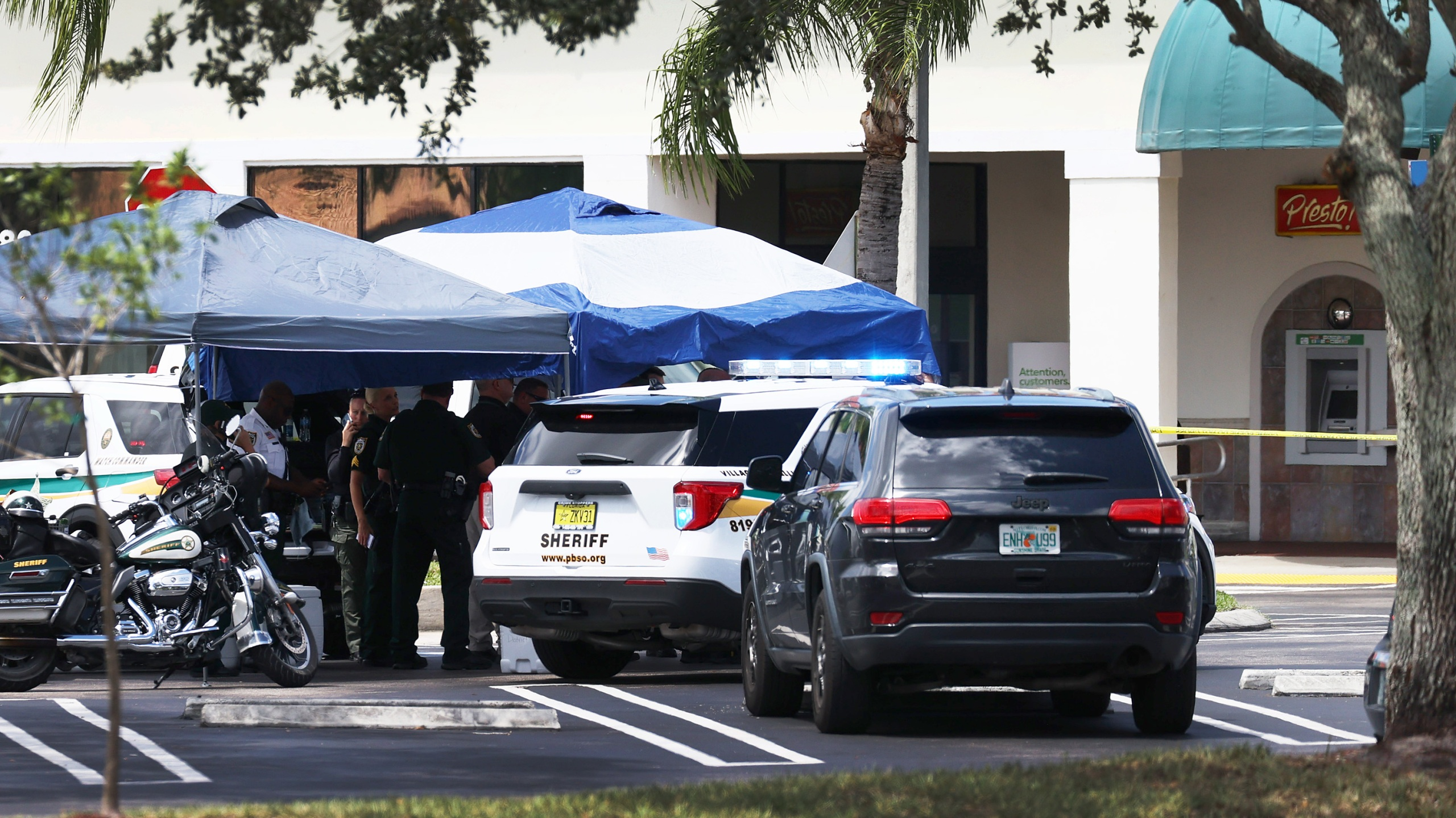 Palm Beach County Sheriff's officers stand outside of a Publix supermarket in Royal Palm Beach, Florida, where a woman, child and a man were found shot to death on June 10, 2021. (Joe Raedle / Getty Images)