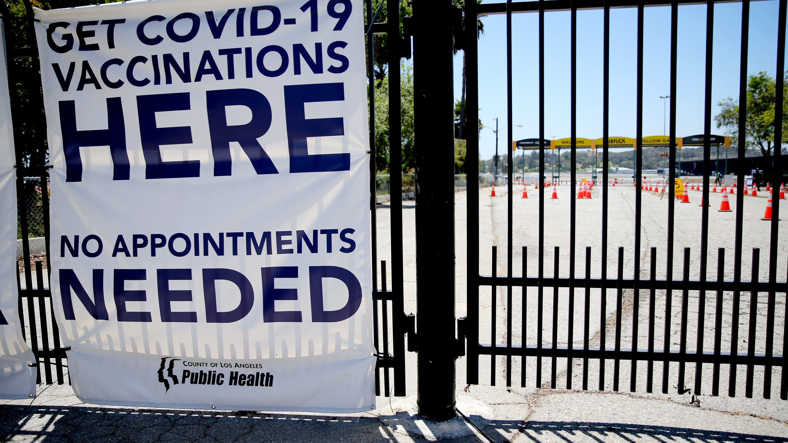 A sign promotes a nearly empty mass vaccination site at the Pomona Fairplex on June 10, 2021 in Pomona, California. (Mario Tama/Getty Images)