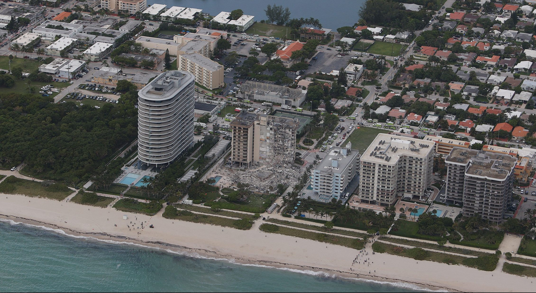 A portion of a 12-story condo tower is seen crumbled to the ground after a partial collapse of the building in Surfside, Florida, on June 24, 2021. (Joe Raedle / Getty Images)