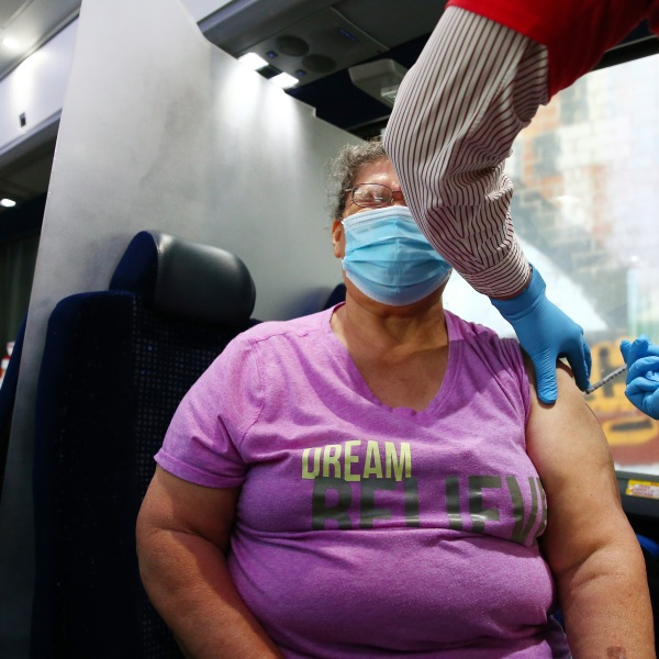 A person receives a COVID-19 vaccination dose at a Walgreens mobile bus clinic on June 25, 2021 in Los Angeles, California. (Mario Tama/Getty Images)