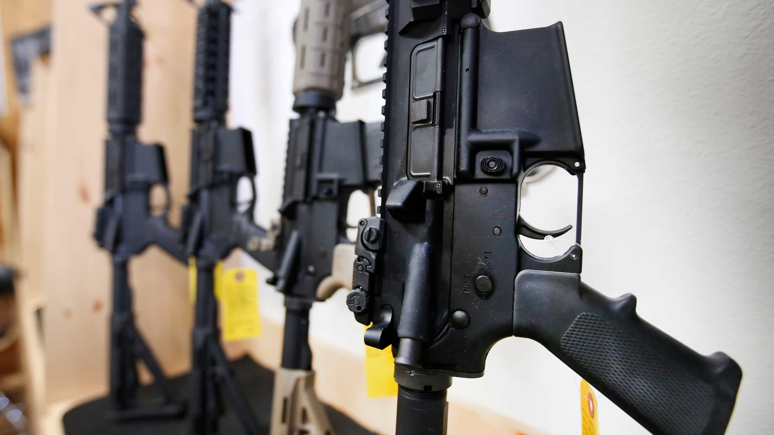 AR-15 semi-automatic guns are on display for sale at on June 17, 2016 in Springville, Utah. (George Frey/Getty Images)