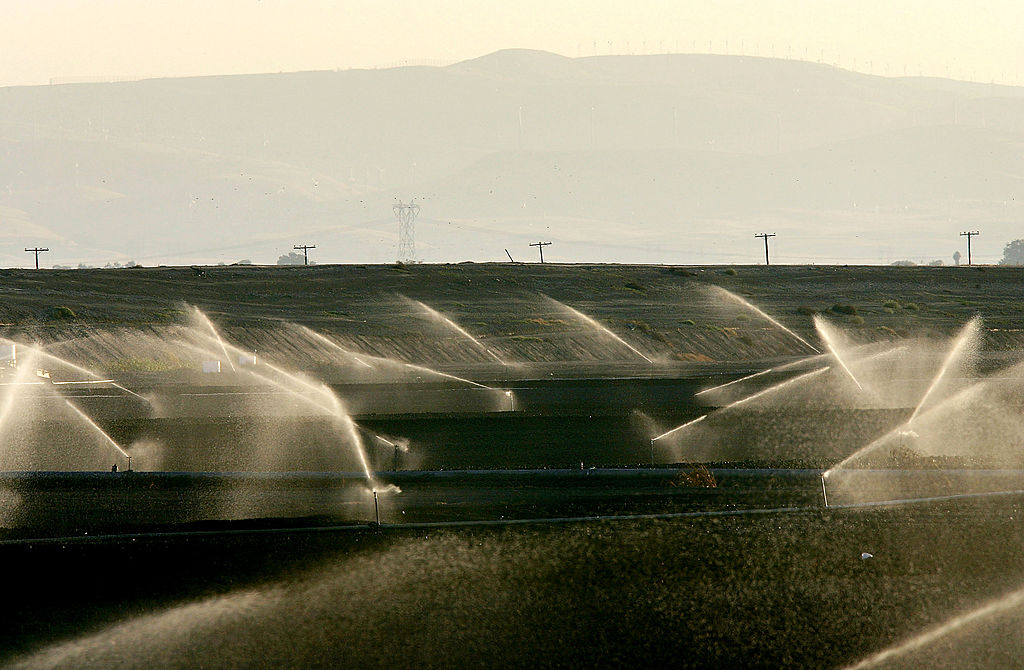 Sprinklers water a field on September 28, 2005 west of Stockton, California. (Photo by David McNew/Getty Images)