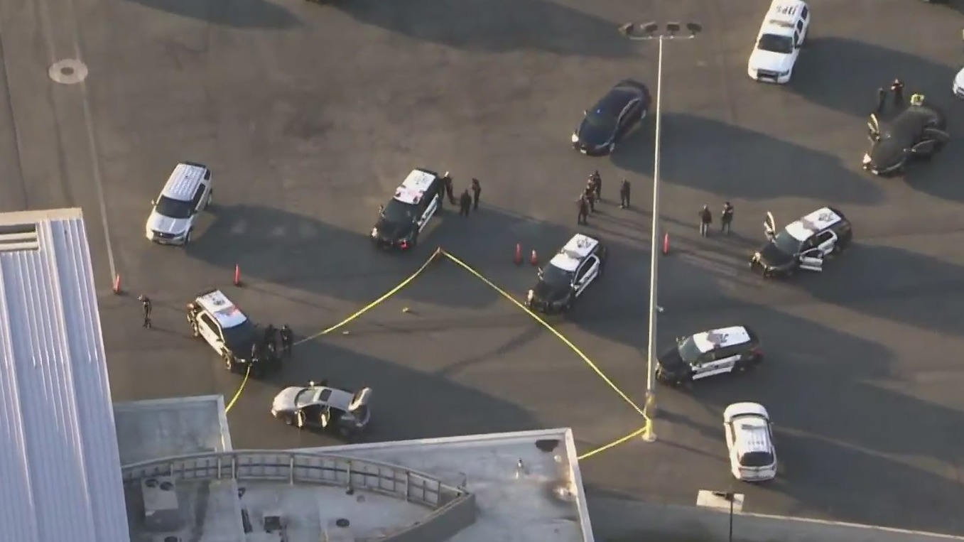 Authorities respond to investigate after a driver broke through a fence at a FedEx cargo facility at the Los Angeles International Airport on June 24, 2021. (KTLA)
