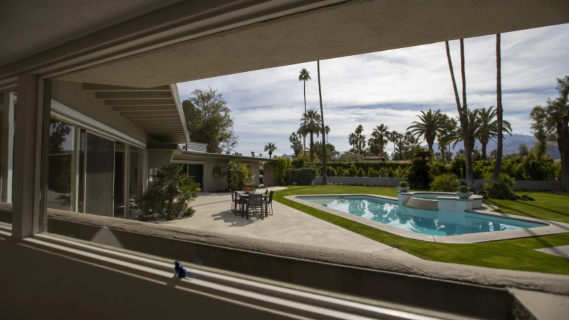 A view of the swimming pool at the Lawrence Welk estate in Palm Springs. The city matched its all-time record of 123 degrees Thursday. (Allen J. Schaben / Los Angeles Times)