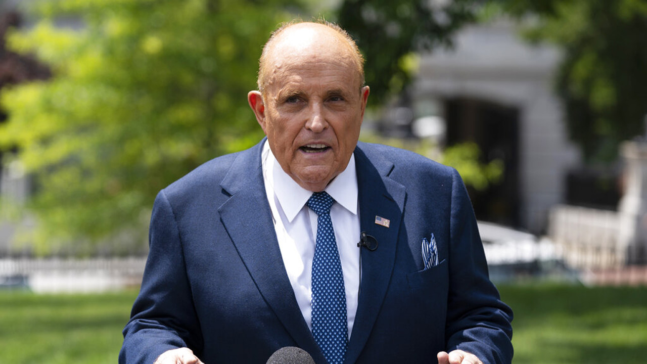 Rudy Giuliani talks with reporters outside the White House on July 1, 2020, in Washington. (AP Photo/Evan Vucci, File)