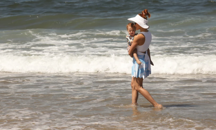 Amy Paffrath plays with daughter Ember Seeley, 1, in the surf at Playa del Rey on June 11.(Al Seib / Los Angeles Times)