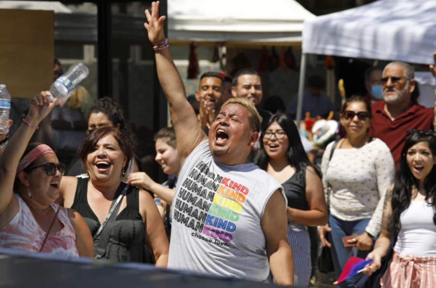 Hector Rocha, center, Cecilia Gonzalez, second from left, and Gabriella Rodriguez, left, enjoy the performances at Orgullo Fest.(Carolyn Cole / Los Angeles Times)