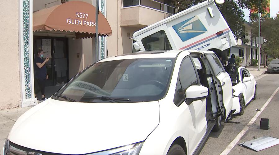 Postal truck lands on top of car after being rear-ended in Valley Village crash