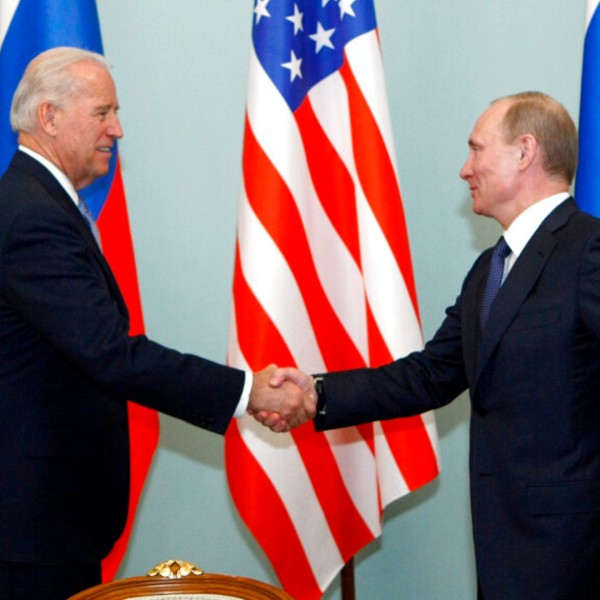 In this March 10, 2011 file photo, then U.S. Vice President Joe Biden, left, shakes hands with Russian Prime Minister Vladimir Putin in Moscow. (AP Photo/Alexander Zemlianichenko)