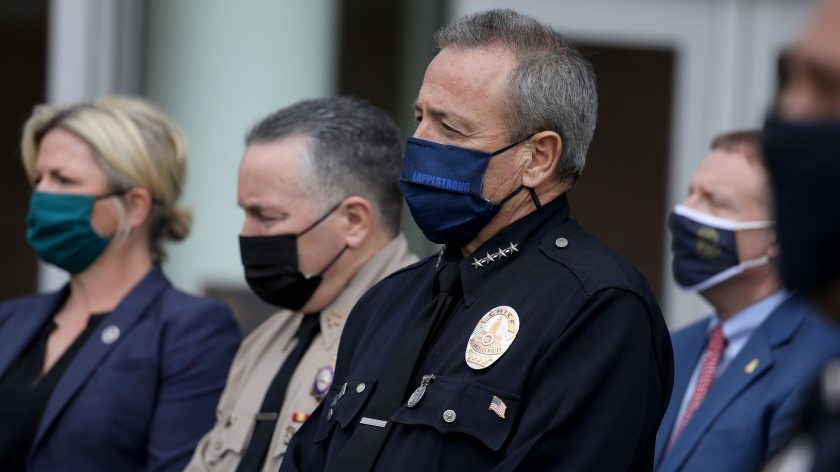 Los Angeles police Chief Michel Moore, in the foreground, is seen in an undated photo. (Gary Coronado / Los Angeles Times)