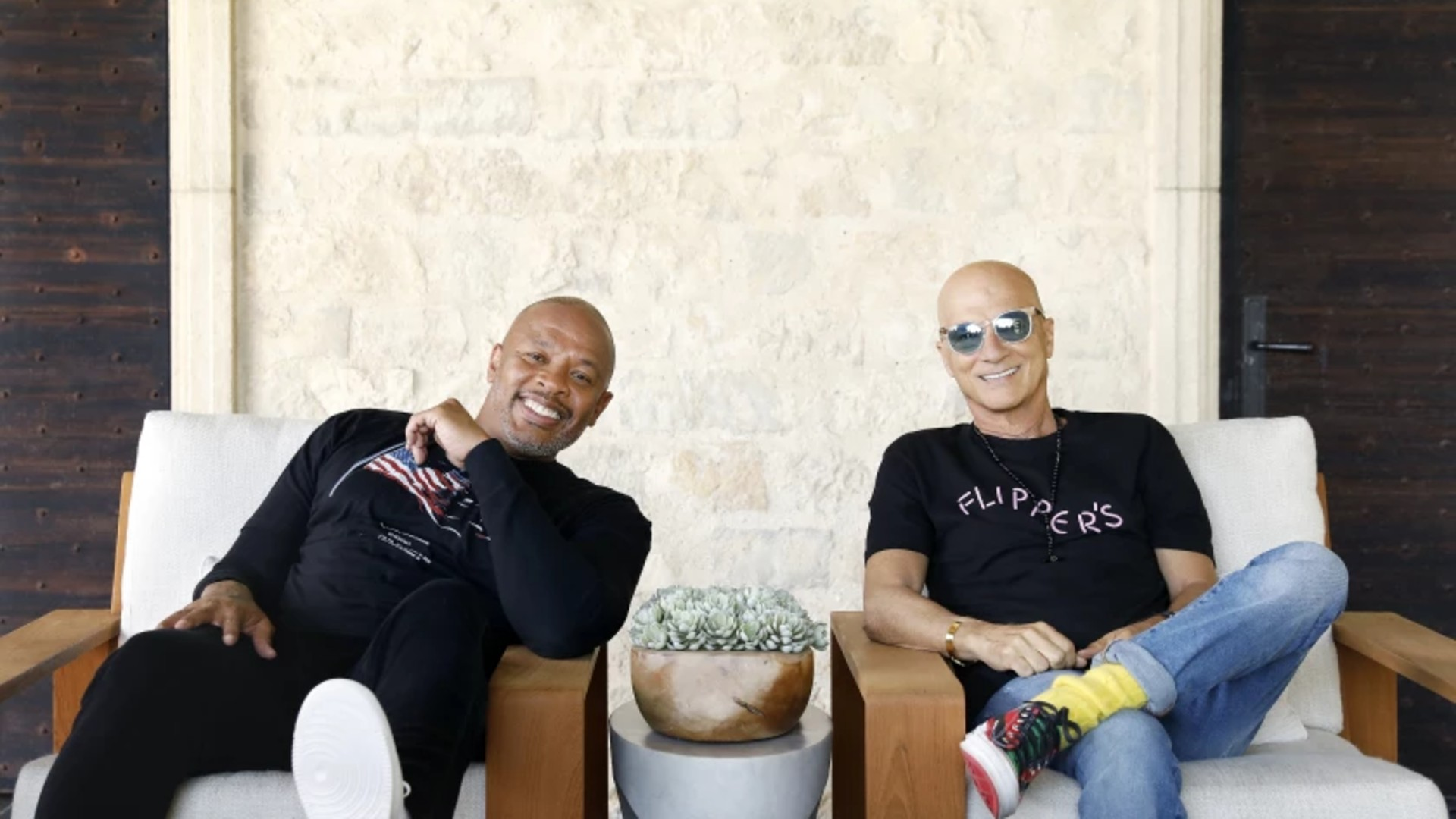 Dr. Dre, left, and Jimmy Iovine, both music moguls from humble roots, are photographed at Dr. Dre's home in Los Angeles on Friday, June 11, 2021. (Christina House / Los Angeles Times)