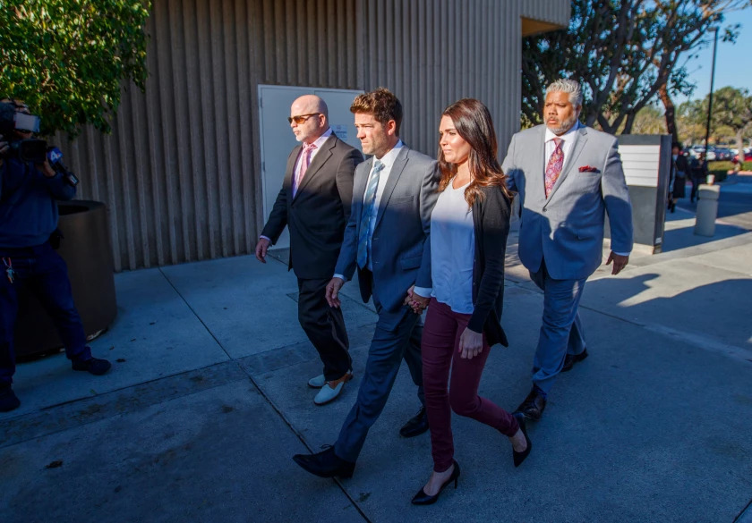 Newport Beach surgeon Grant Robicheaux and girlfriend Cerissa Riley arrive at the Harbor Justice Center for a hearing in 2020.(Allen J. Schaben / Los Angeles Times)