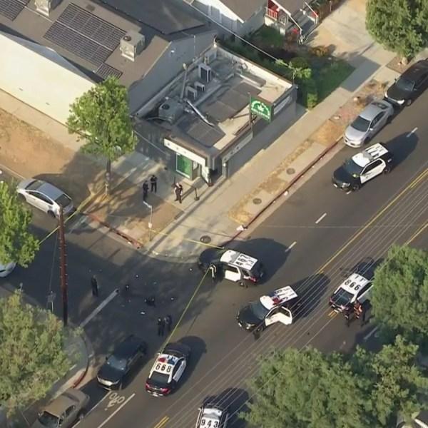 Police respond to investigate a deadly shooting at a Highland Park marijuana dispensary on June 17, 2021. (KTLA)