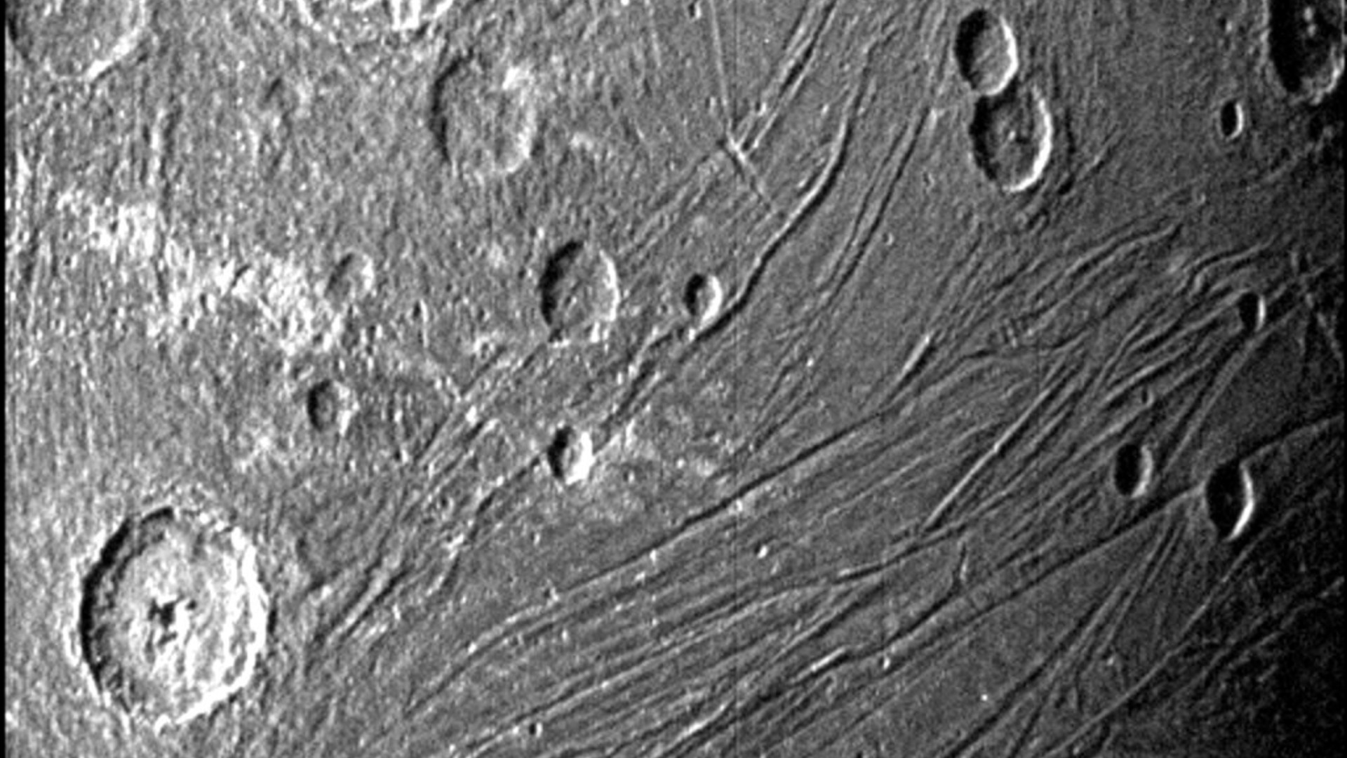 This June 7, 2021 image made available by NASA shows the dark side of the Jovian moon Ganymede as the Juno spacecraft flies by. (NASA/JPL-Caltech/SwRI via AP)