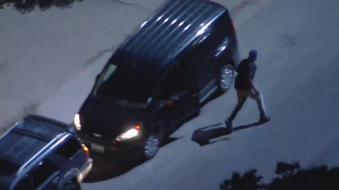 A driver flees a pursuit vehicle after crashing in North Hollywood on June 17, 2021. (KTLA)