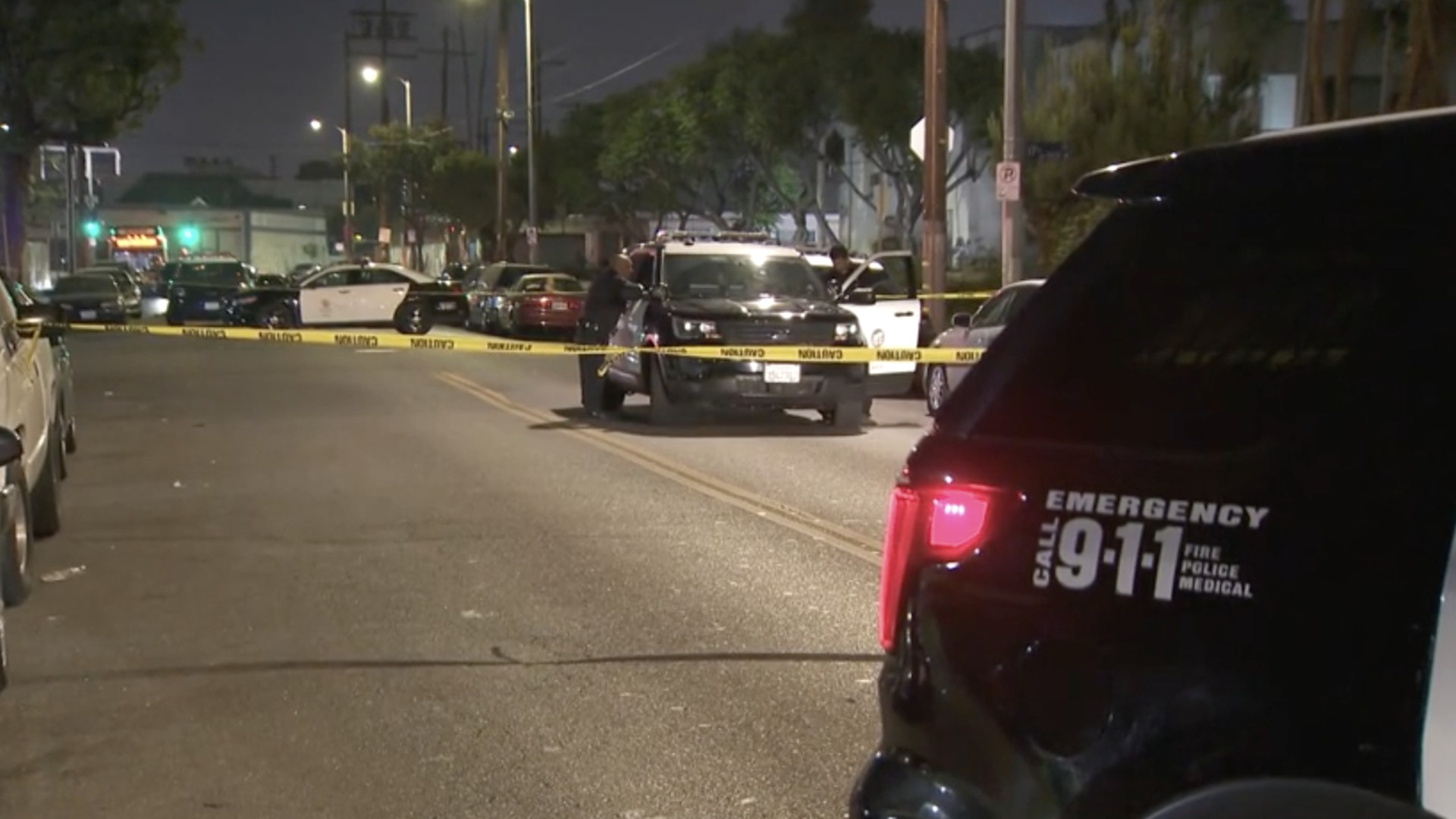 Los Angeles police investigate a triple shooting that left one person dead on June 16, 2021. (KTLA)