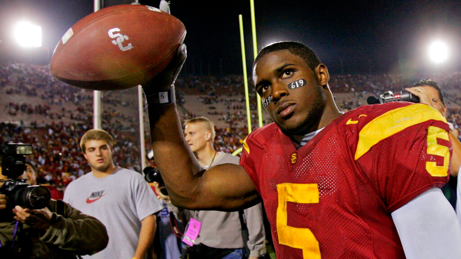 In this Nov. 19, 2005, file photo, Southern California tail back Reggie Bush walks off the field holding the game ball after the Trojans defeated Fresno State at the Los Angeles Coliseum. (AP Photo/Kevork Djansezian, File)