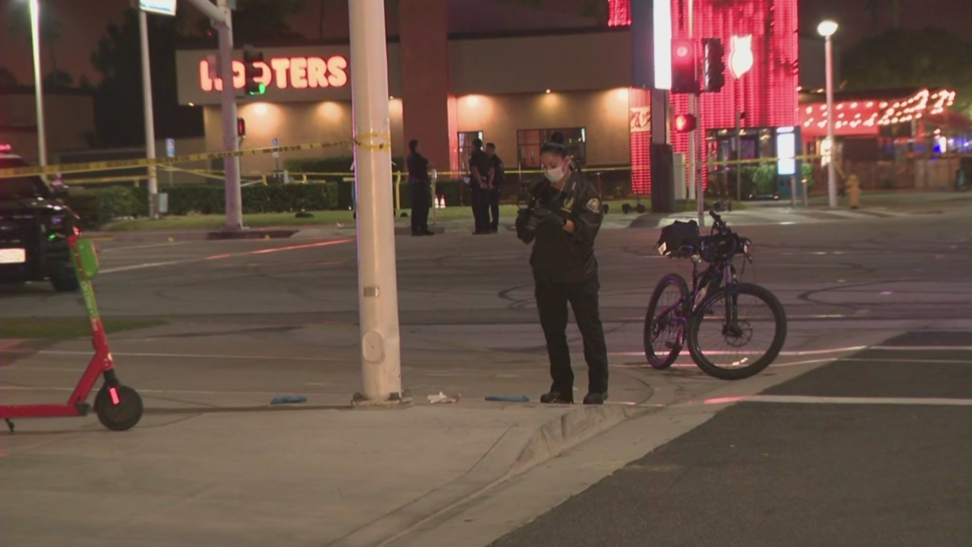 Long Beach police investigate a drive-by shooting outside The Pike Outlets in downtown Long Beach Saturday, June 26, 2021. (KTLA)