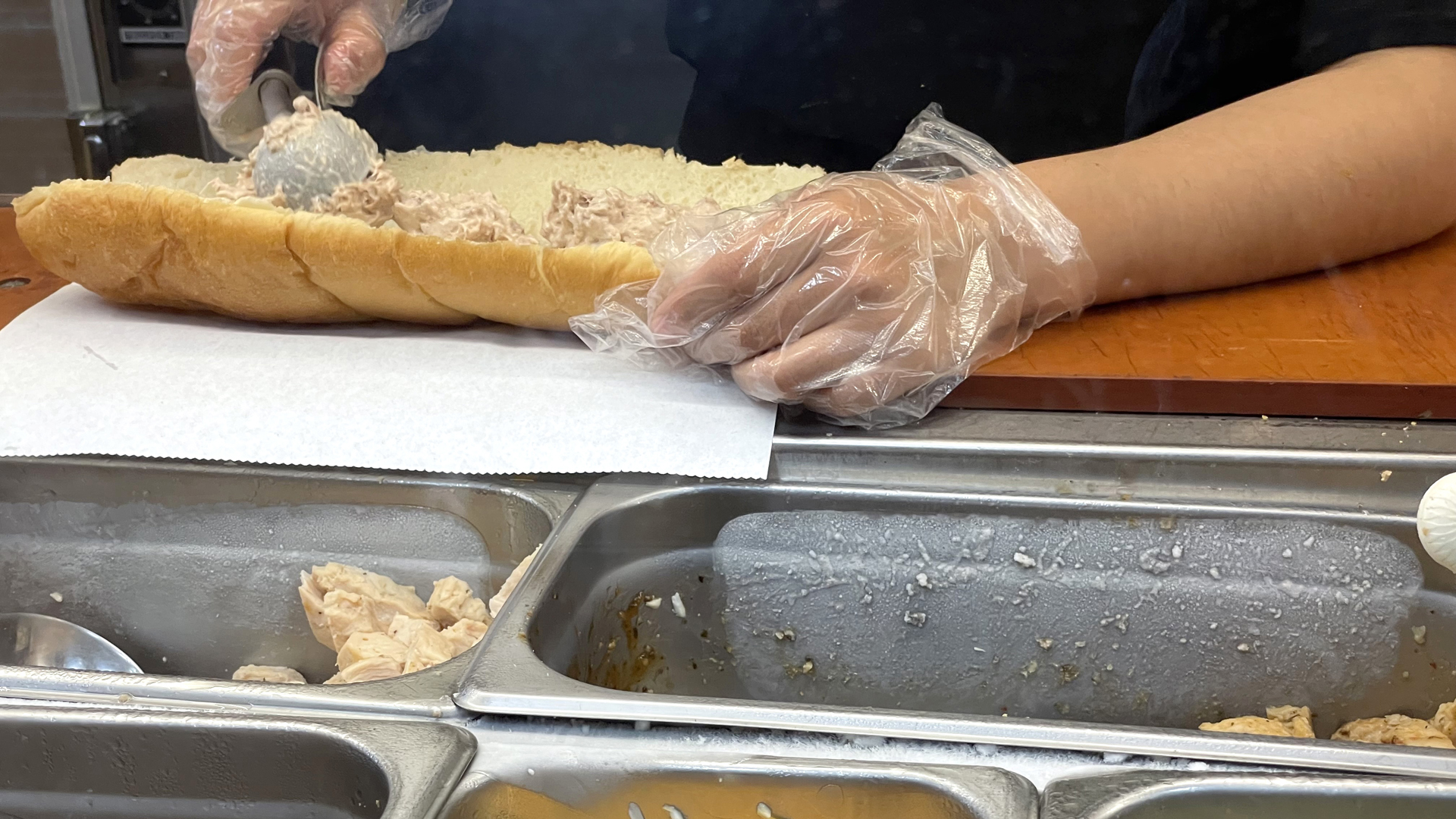 A worker at a Subway sandwich shop makes a tuna sandwich on June 22, 2021 in San Anselmo, California. A recent lab analysis of tuna used in Subway sandwiches commissioned by the New York Times did not reveal any tuna DNA in samples taken from Subway tuna sandwiches. The lab was unable to pinpoint a species in the tuna samples from three Los Angeles area Subway sandwich shops. (Justin Sullivan/Getty Images)