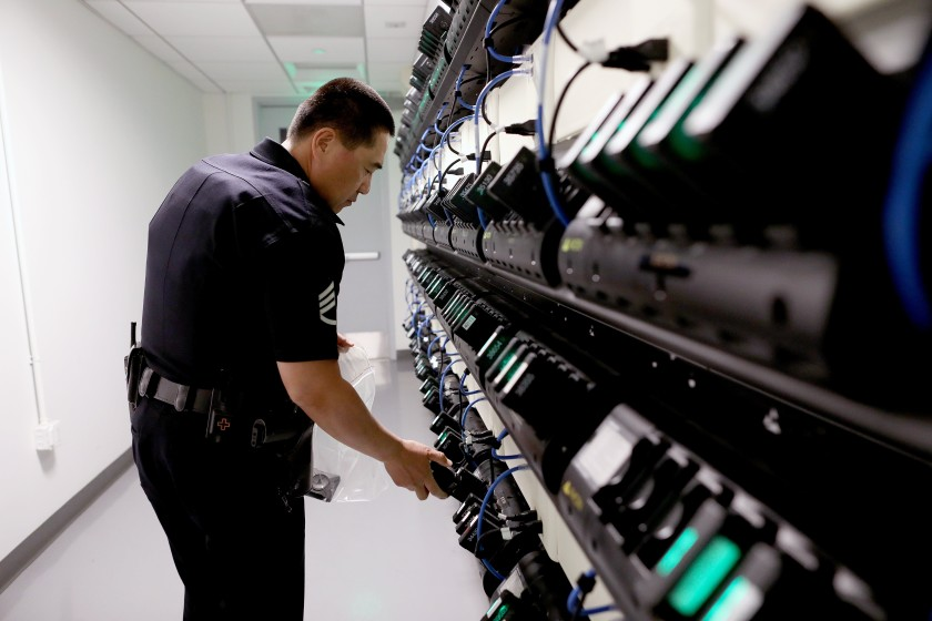 An LAPD officer is seen next to body cameras in an undated photo. (Gary Coronado / Los Angeles Times)