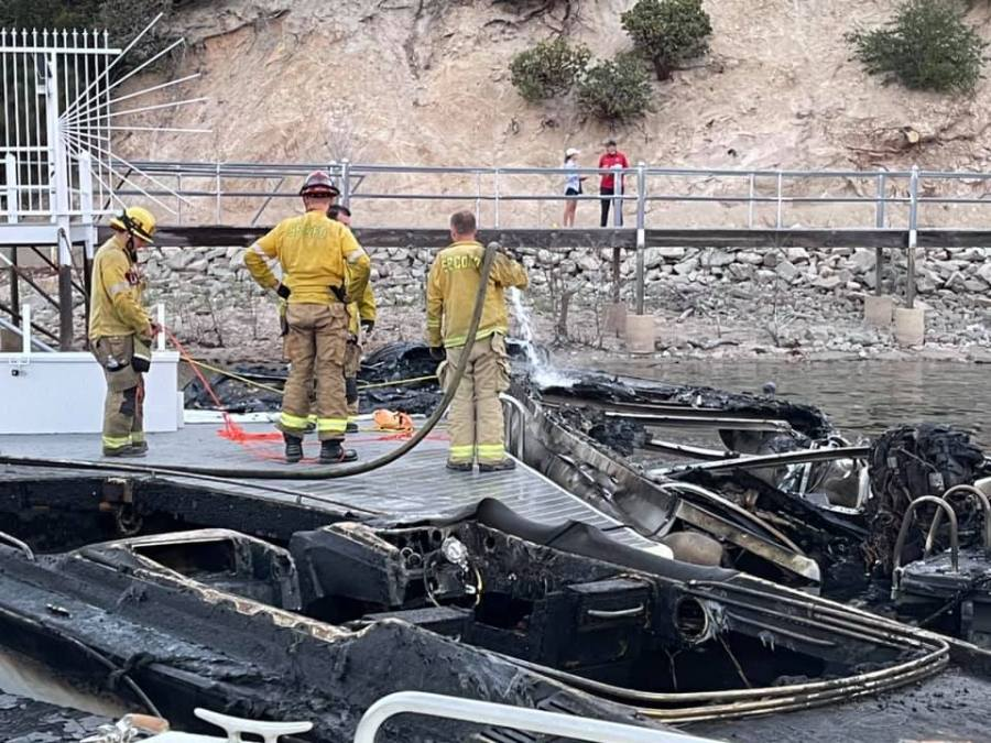 The aftermath of a fire that burned multiple boats and damaged a dock on Lake Arrowhead on July 16, 2021. (San Bernardino County Fire)