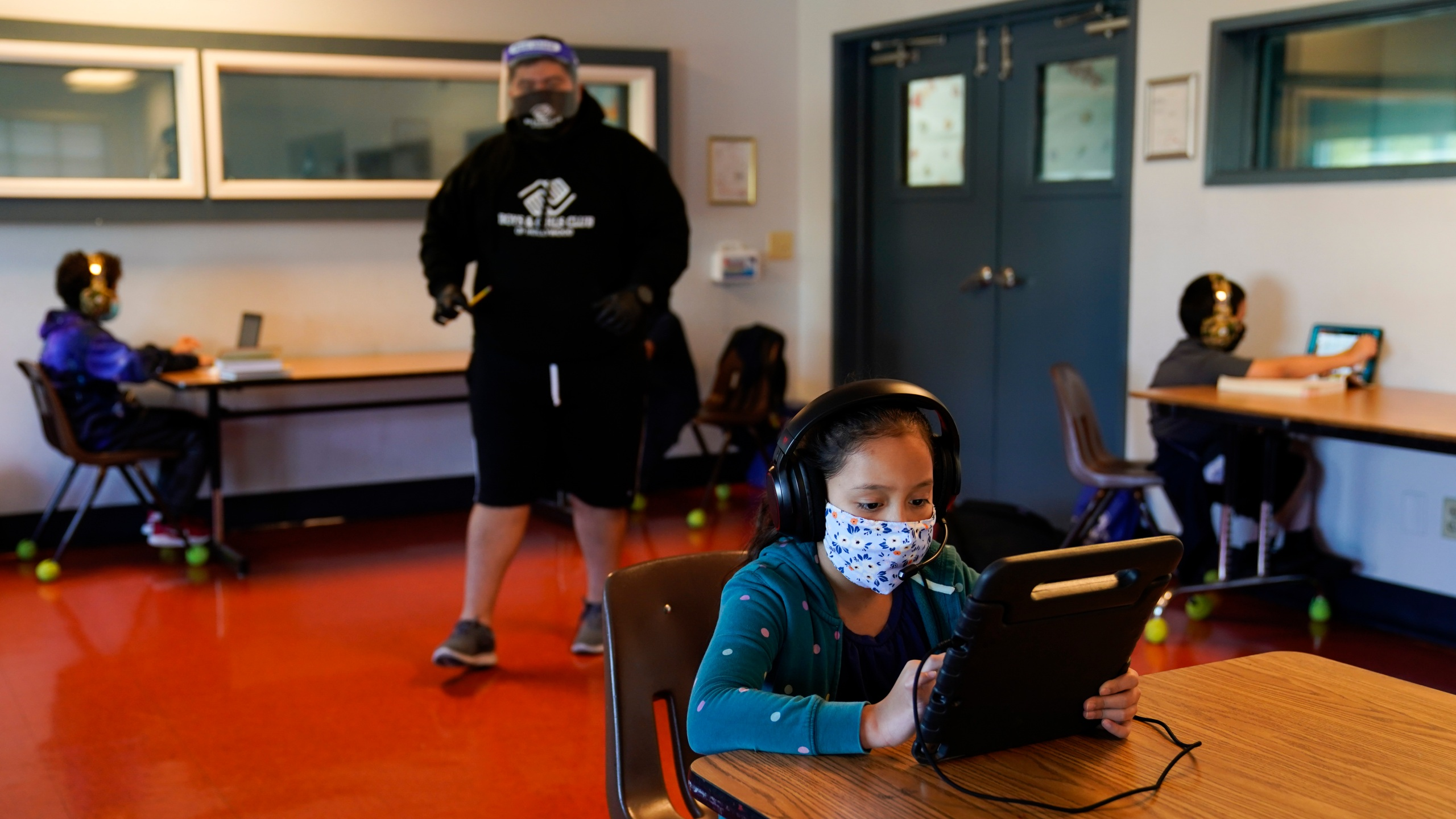 Los Angeles Unified School District students attend online classes at the Boys & Girls Club of Hollywood on Aug. 26, 2020. (Jae C. Hong / Associated Press)