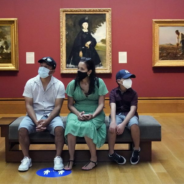 Visitors wear masks while viewing art at the newly re-opened Getty Center on May 26, 2021. (Marcio Jose Sanchez / Associated Press)