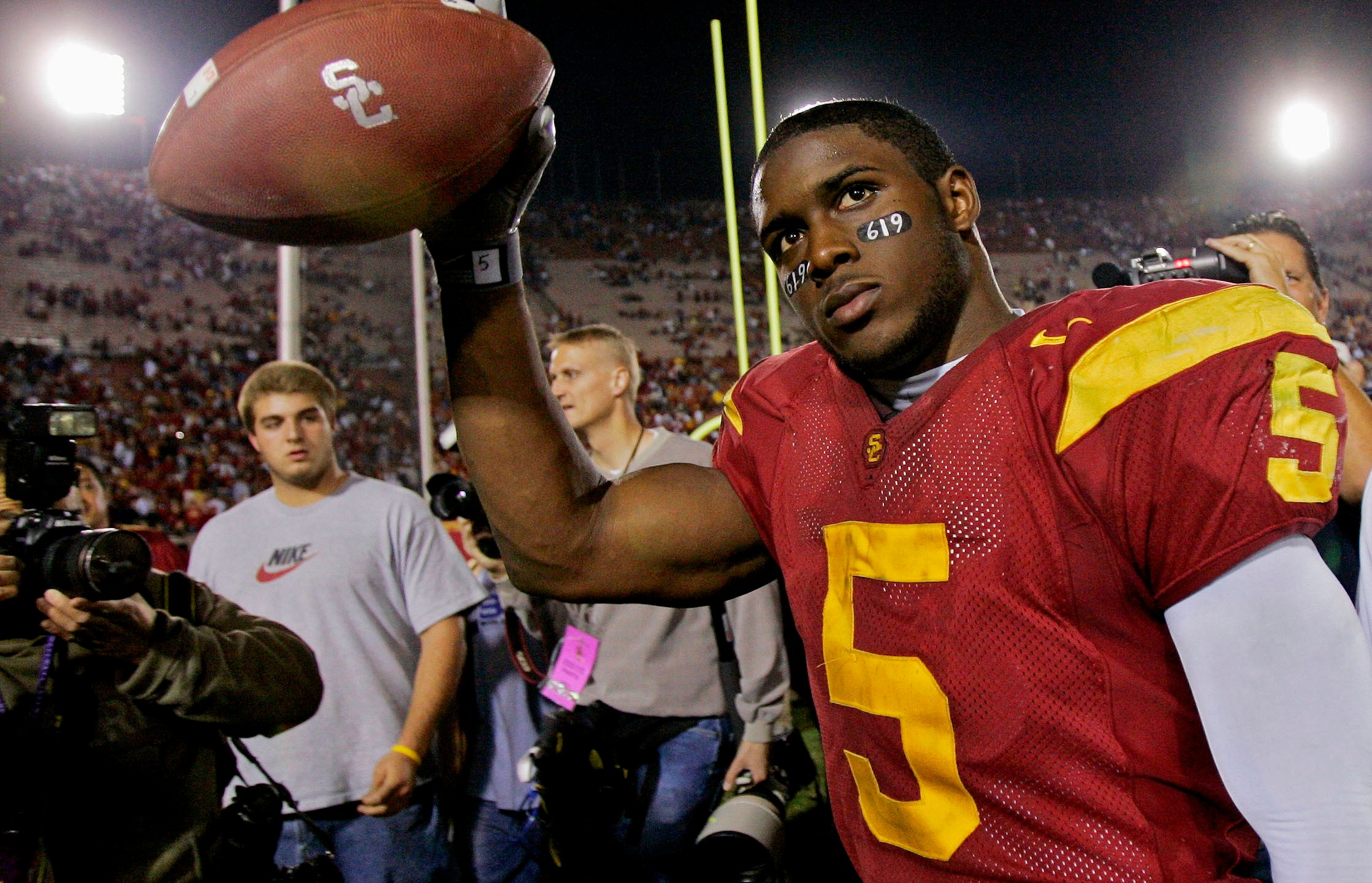 Southern California tail back Reggie Bush walks off the field holding the game ball after the Trojans defeated Fresno State, 50-42, at the Los Angeles Coliseum on Nov. 19, 2005. (Kevork Djansezian / Associated Press)