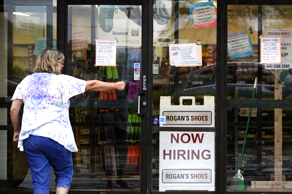 A hiring sign is displayed outside a retail store in Buffalo Grove, Ill., Thursday, June 24, 2021. (AP Photo/Nam Y. Huh)