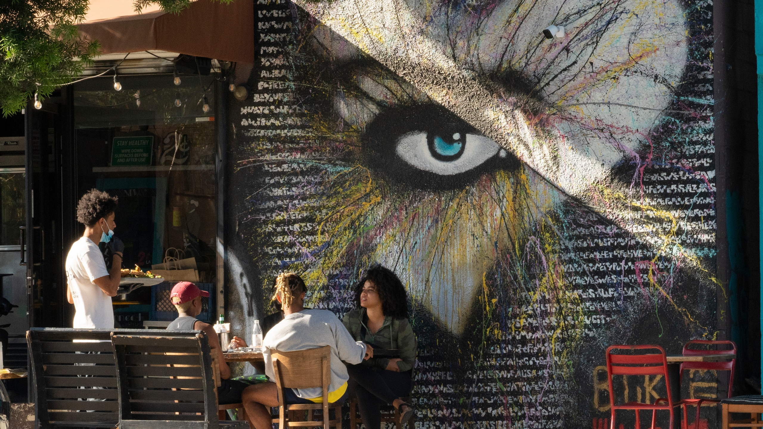 In this June 5, 2021, file photo, people eat outdoors outdoors at a soul food restaurant in Los Angeles. (AP Photo/Damian Dovarganes, File)