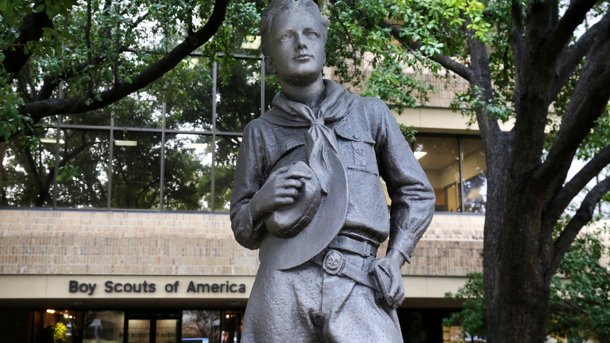 In this Feb. 12, 2020 file photo, a statue stands outside the Boy Scouts of America headquarters in Irving, Texas. The Boy Scouts of America have reached an agreement with attorneys representing some 60,000 victims of child sex abuse in what could prove to be a pivotal moment in the organization's bankruptcy case. Attorneys for the BSA filed court papers late Thursday, July 1, 2021 outlining a restructuring support agreement, or RSA, with attorneys representing abuse victims. (AP Photo/LM Otero, File)