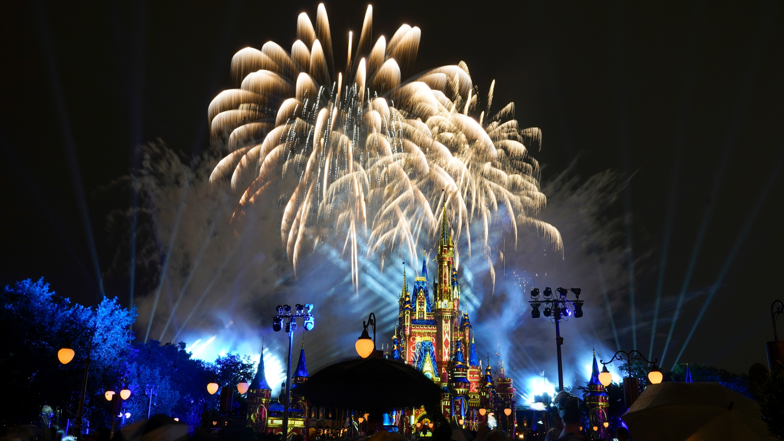 After a shutdown because of the coronavirus, fireworks fill the sky for the first time in 15 months at the Magic Kingdom at Walt Disney World, July 1, 2021, in Lake Buena Vista, Fla. (AP Photo/John Raoux)