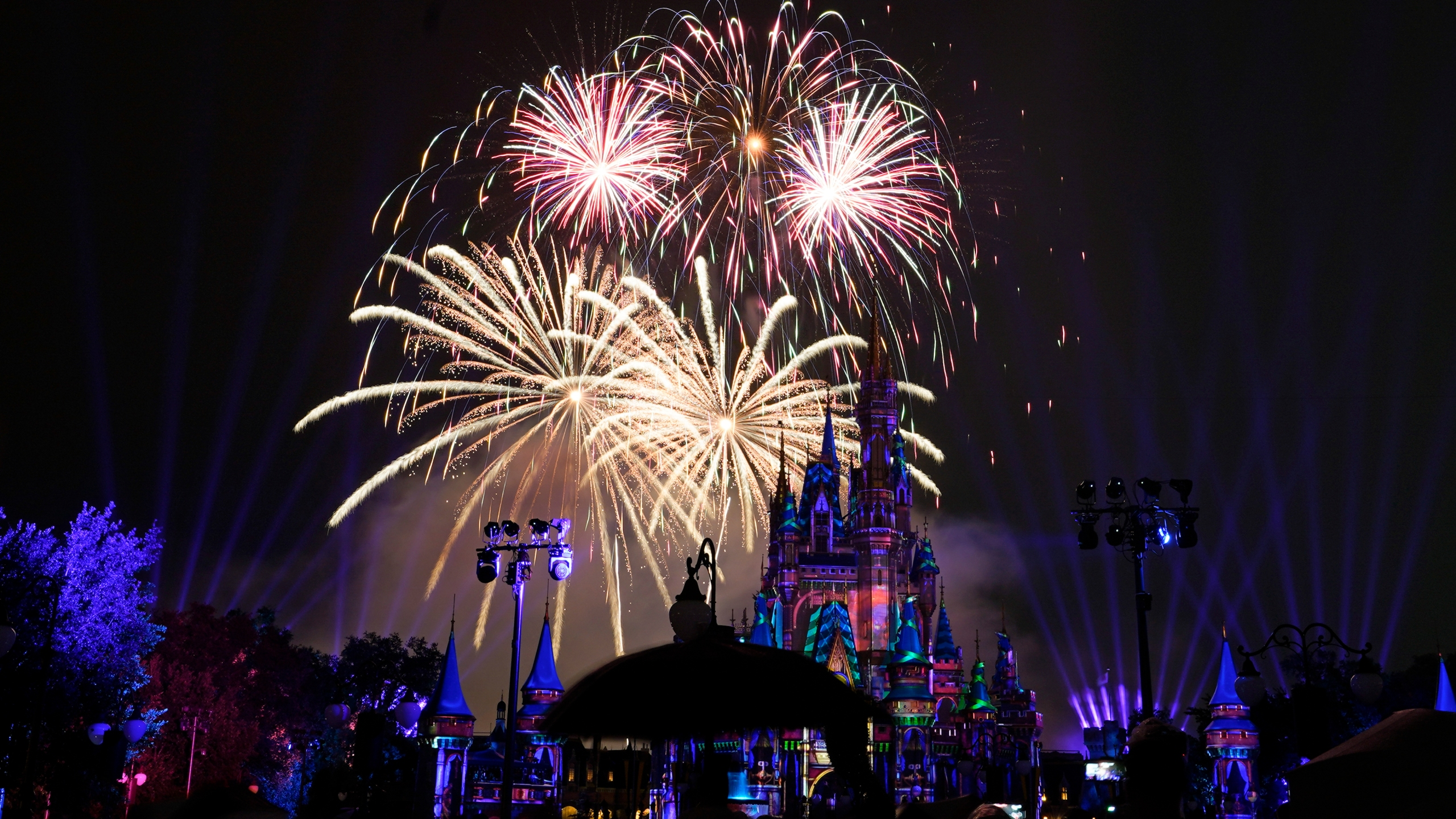 After a shutdown because of the coronavirus, fireworks fill the sky for the first time in 15 months at the Magic Kingdom at Walt Disney World in Lake Buena Vista, Fla., on July 1, 2021. (John Raoux / Associated Press)