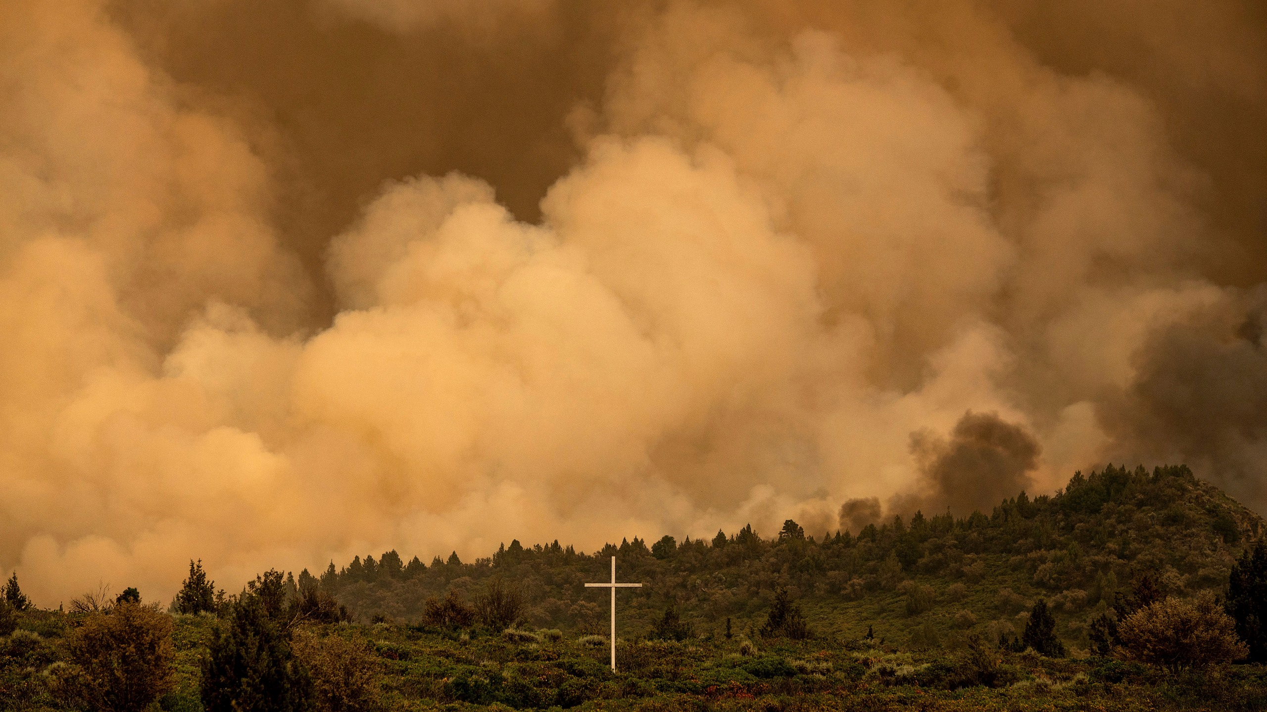 Smoke from the Lava Fire billows above Highway 97 in Weed, Calif., Thursday, July 1, 2021. Firefighters are battling multiple fires in the region following high temperatures and lightning strikes. (AP Photo/Noah Berger)