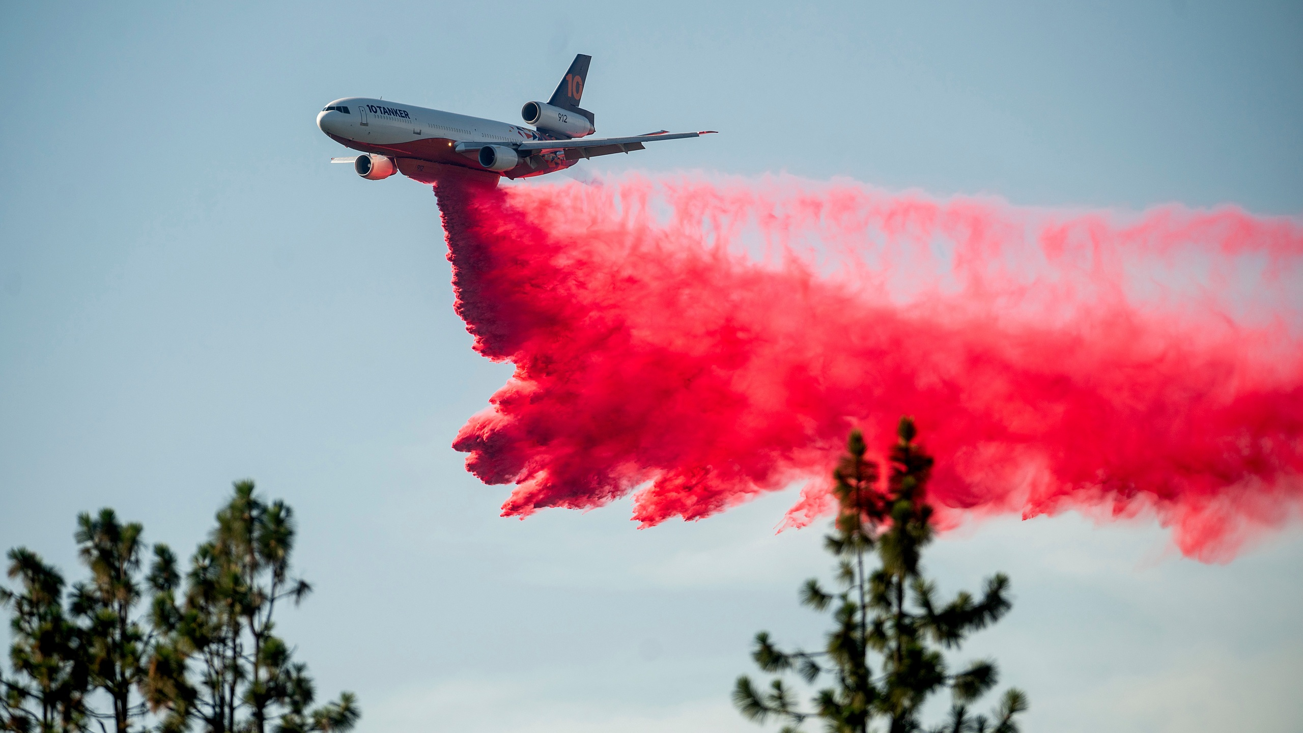 A DC-10 air tanker drops retardant while battling the Salt Fire near the Lakehead community of Unincorporated Shasta County, Calif., on Friday, July 2, 2021. (AP Photo/Noah Berger)