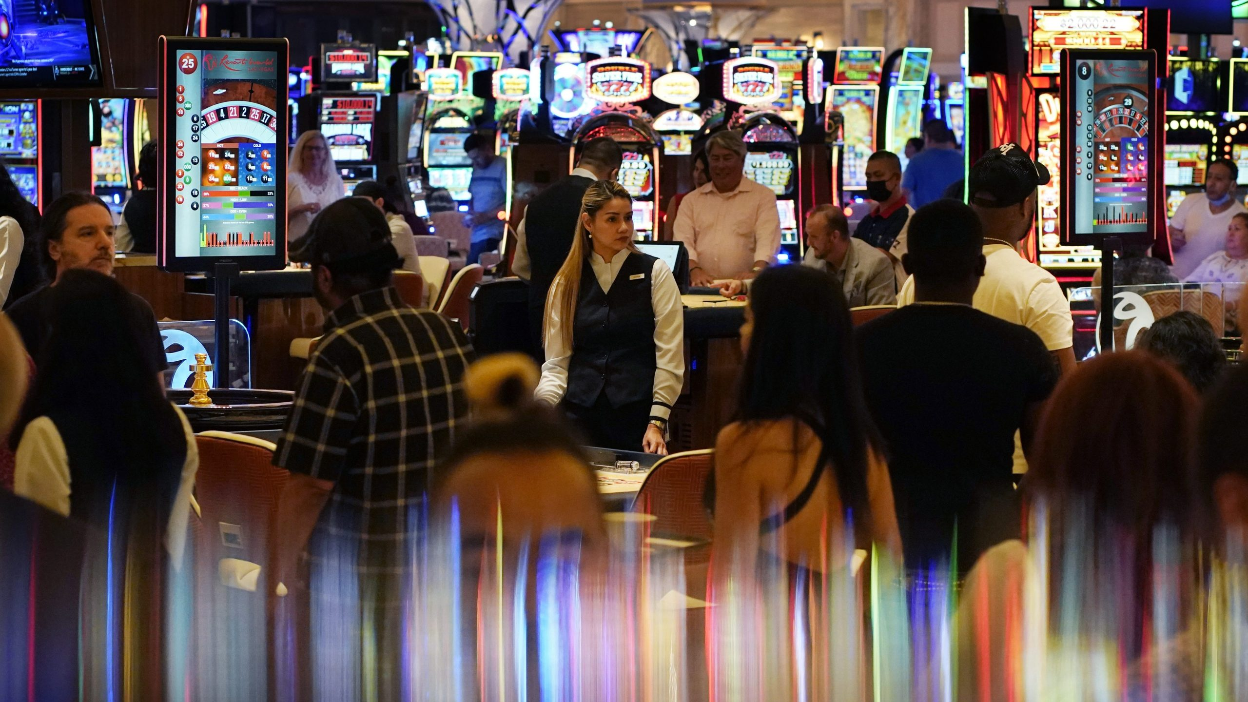 In this June 24, 2021, photo, crowds walk through the casino during the opening night of Resorts World Las Vegas in Las Vegas. (John Locher / Associated Press)