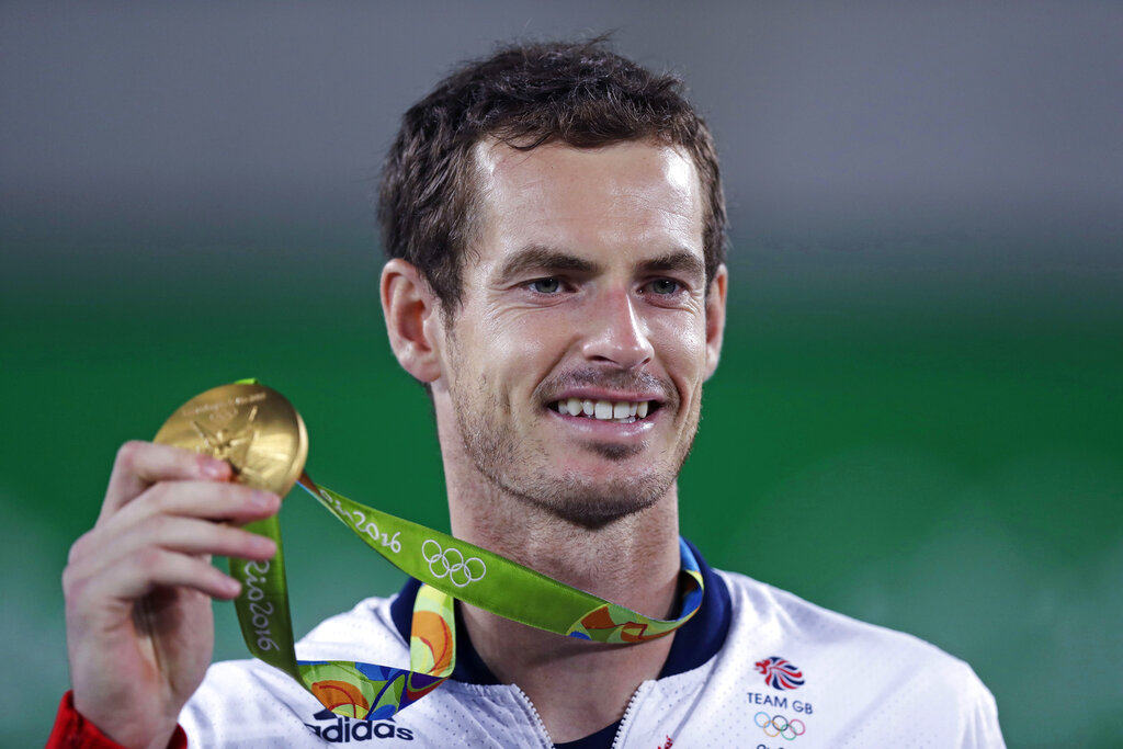 Andy Murray, of England, smiles as he holds up his gold medal at the 2016 Summer Olympics in Rio de Janeiro, Brazil, in this Sunday, Aug. 14, 2016, file photo. (AP Photo/Charles Krupa, File)