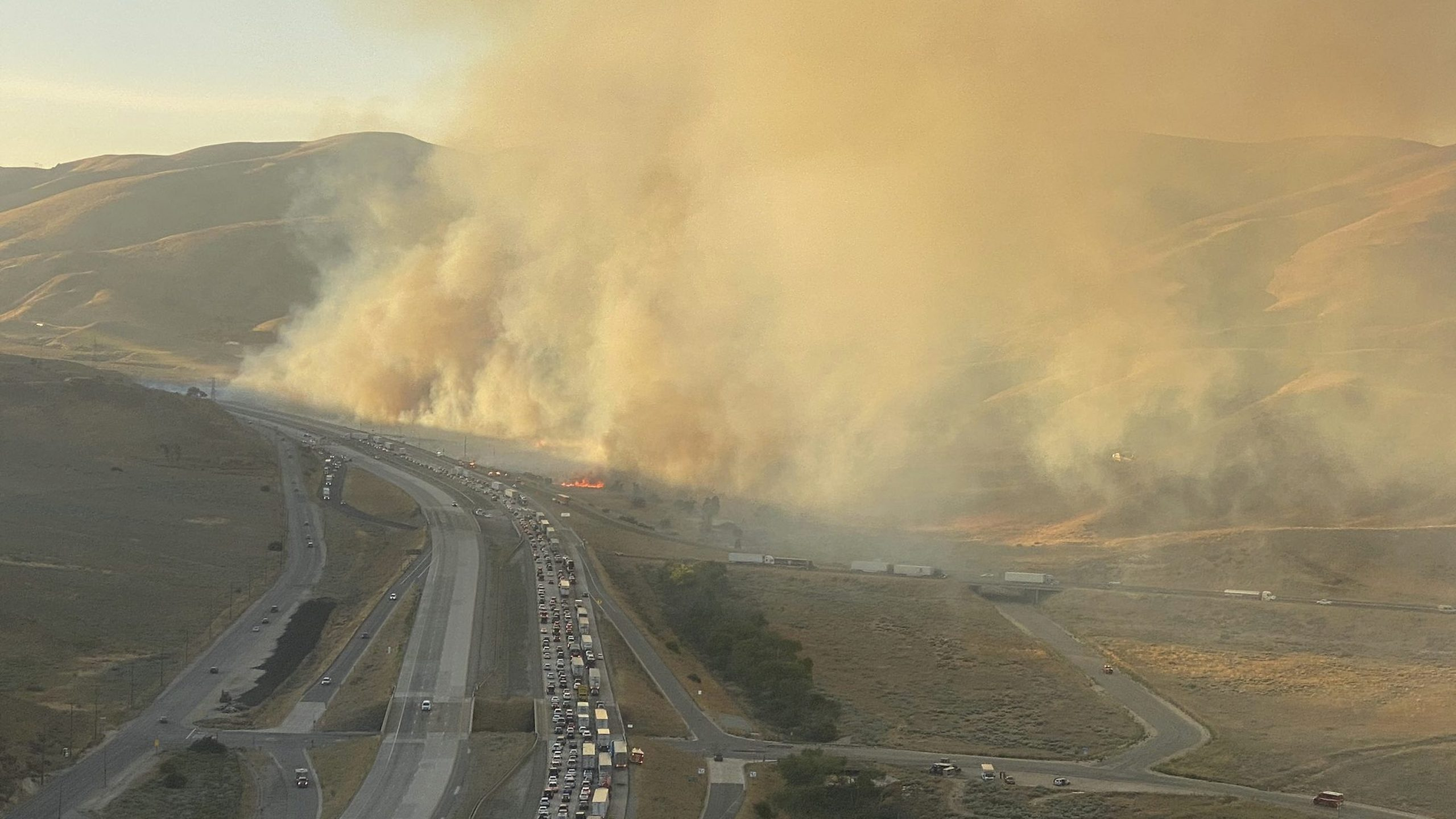This aerial picture released via @LACoFireAirOps by the Los Angeles County Fire Department Air Operations shows the Tumbleweed Fire along the 5 Freeway in Gorman on July 4, 2021.
