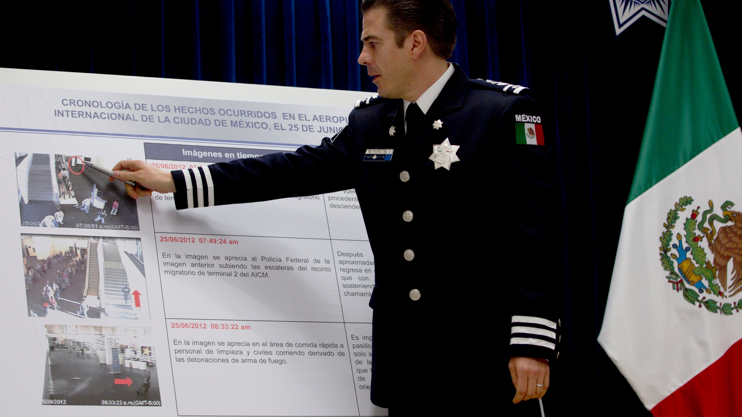 In this June 28, 2012 file photo, Luis Cardenas Palomino, chief of the regional security division of Mexico's federal police, points to surveillance camera footage at the international airport related to a shooting, during a press conference in Mexico City. Mexico said Monday, July 5, 2021, that it has arrested the former leading police officers on charges of torture from nearly a decade ago. (AP Photo/Esteban Felix, File)