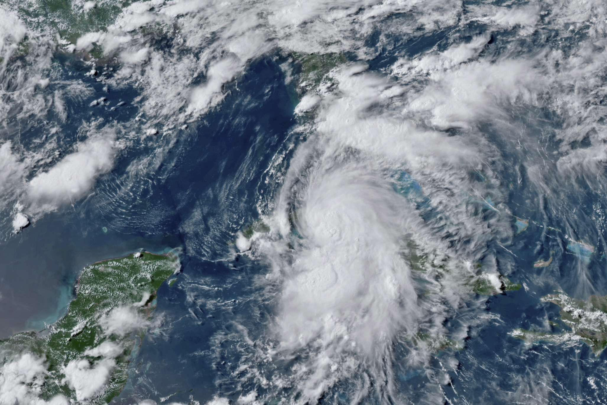 This GOES-16 GeoColor satellite image taken July 5, 2021, at 4:50 p.m. EDT, and provided by NOAA, shows Tropical Storm Elsa over western Cuba with strong rain and winds. (NOAA via Associated Press)
