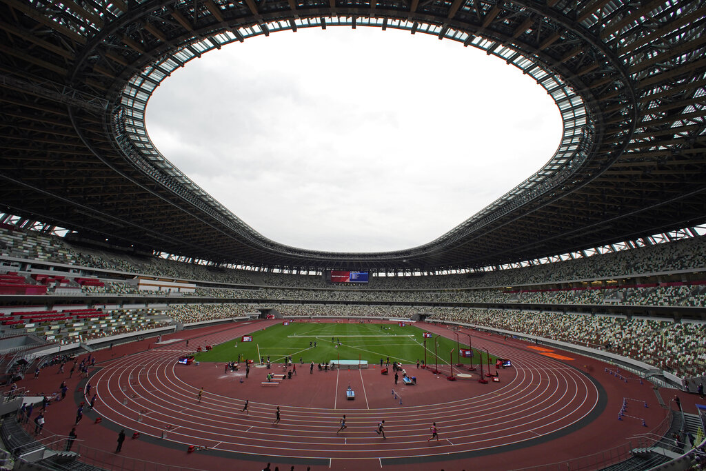 In this May 11, 2021, file photo, athletes compete in the men's 400-meter T20 race during an athletics test event for the Tokyo 2020 Paralympics Games at National Stadium in Tokyo. (AP Photo/Shuji Kajiyama, File)