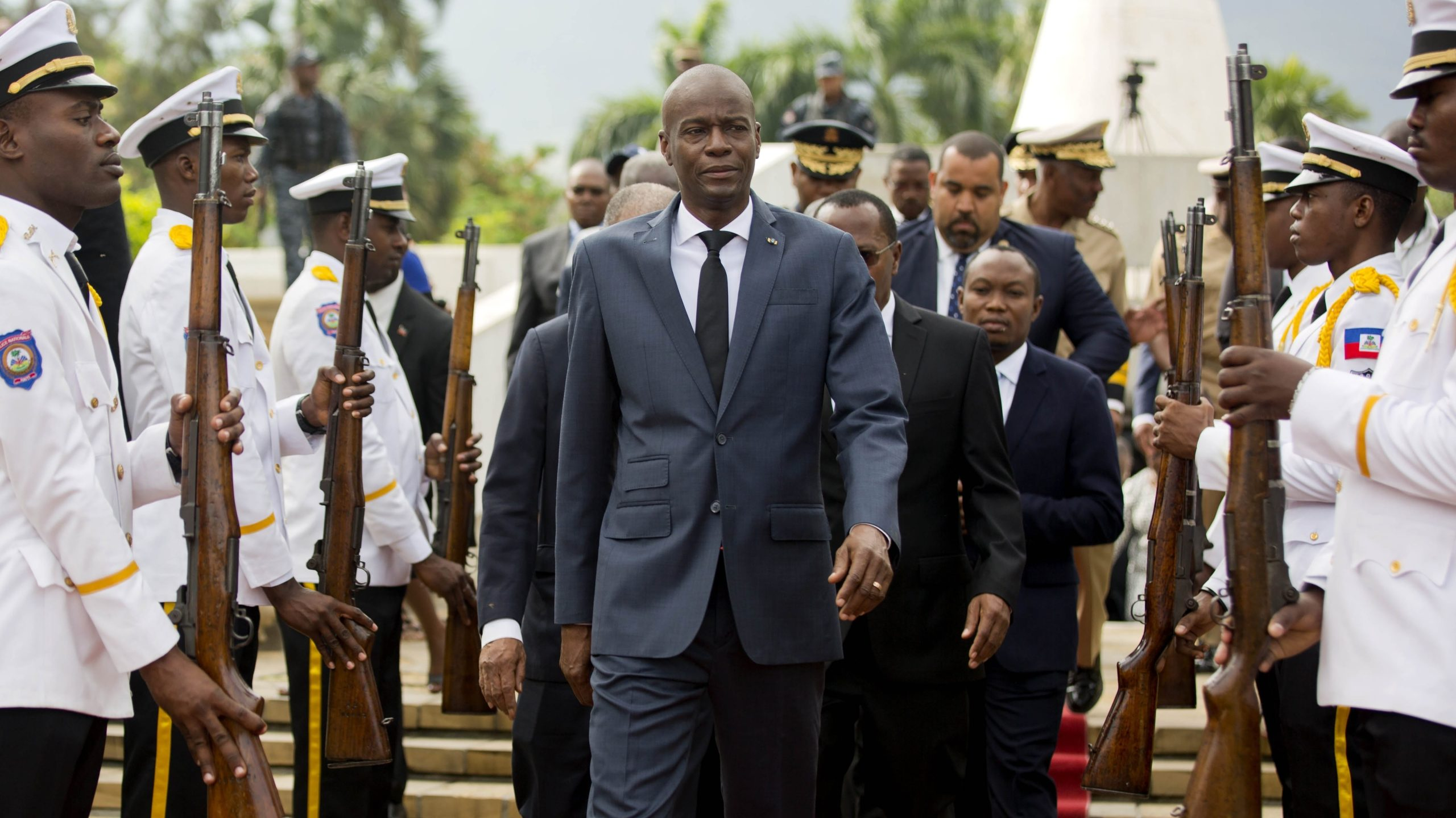 Haiti's President Jovenel Moise, center, leaves the museum during a ceremony marking the 215th anniversary of revolutionary hero Toussaint Louverture's death, at the National Pantheon museum in Port-au-Prince, Haiti, on April 7, 2018. (Dieu Nalio Chery / Associated Press)