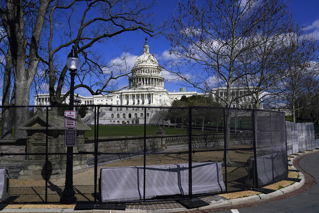 In this April 2, 2021, file photo the U.S. Capitol is seen behind security fencing on Capitol Hill in Washington. (AP Photo/Carolyn Kaster, File)