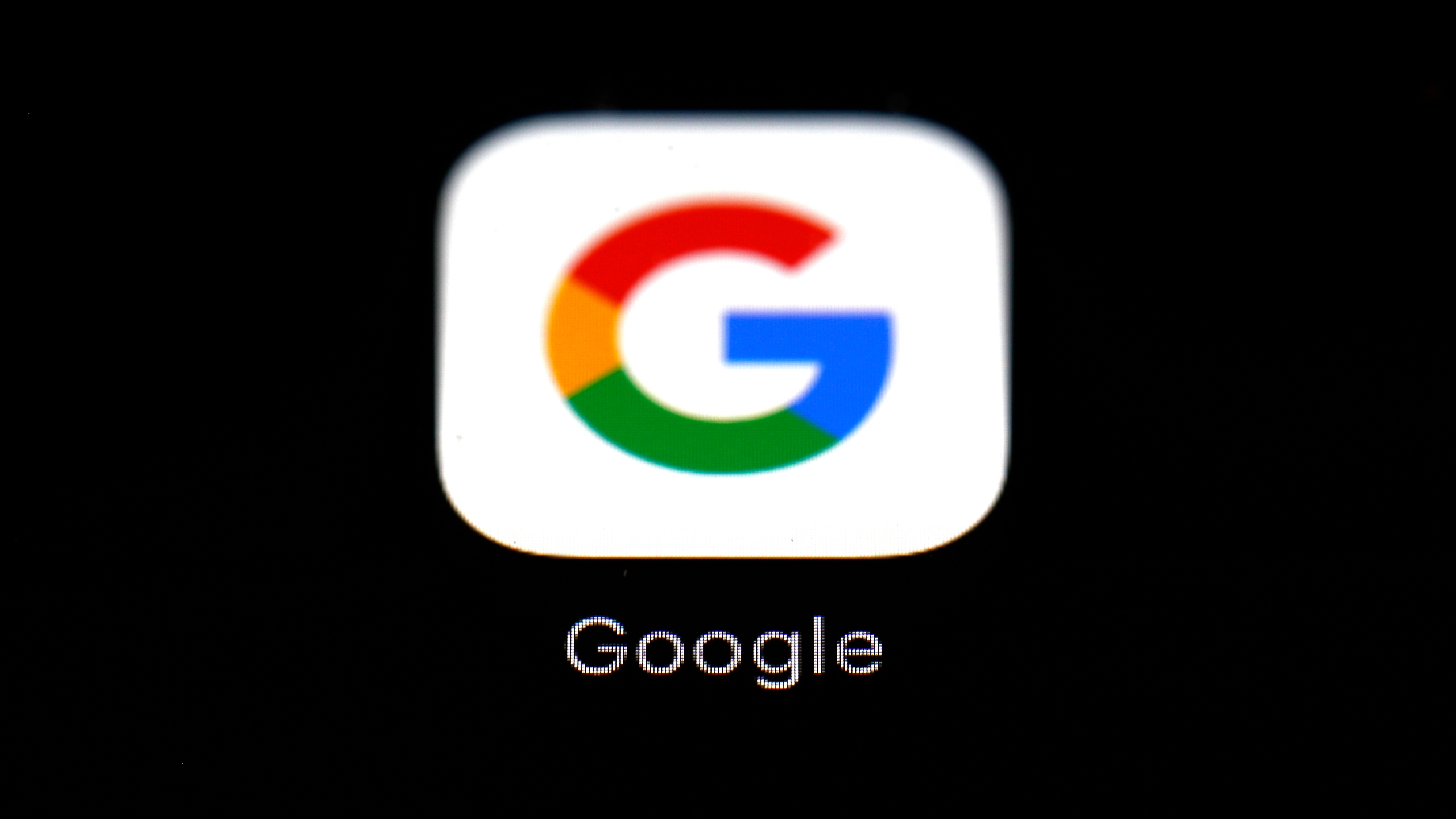 This March 19, 2018 file photo shows the Google app on an iPad in Baltimore. Dozens of states are taking aim at Google in an escalating legal offensive on Big Tech. This time it's a lawsuit targeting the Google's Play store, where consumers download most of the apps designed for the Android software that powers most of the world's smartphones. The complaint filed late Wednesday, July 7, 2021 represents the fourth major antitrust filed against Google by government agencies across the U.S. since last October. (AP Photo/Patrick Semansky, File)