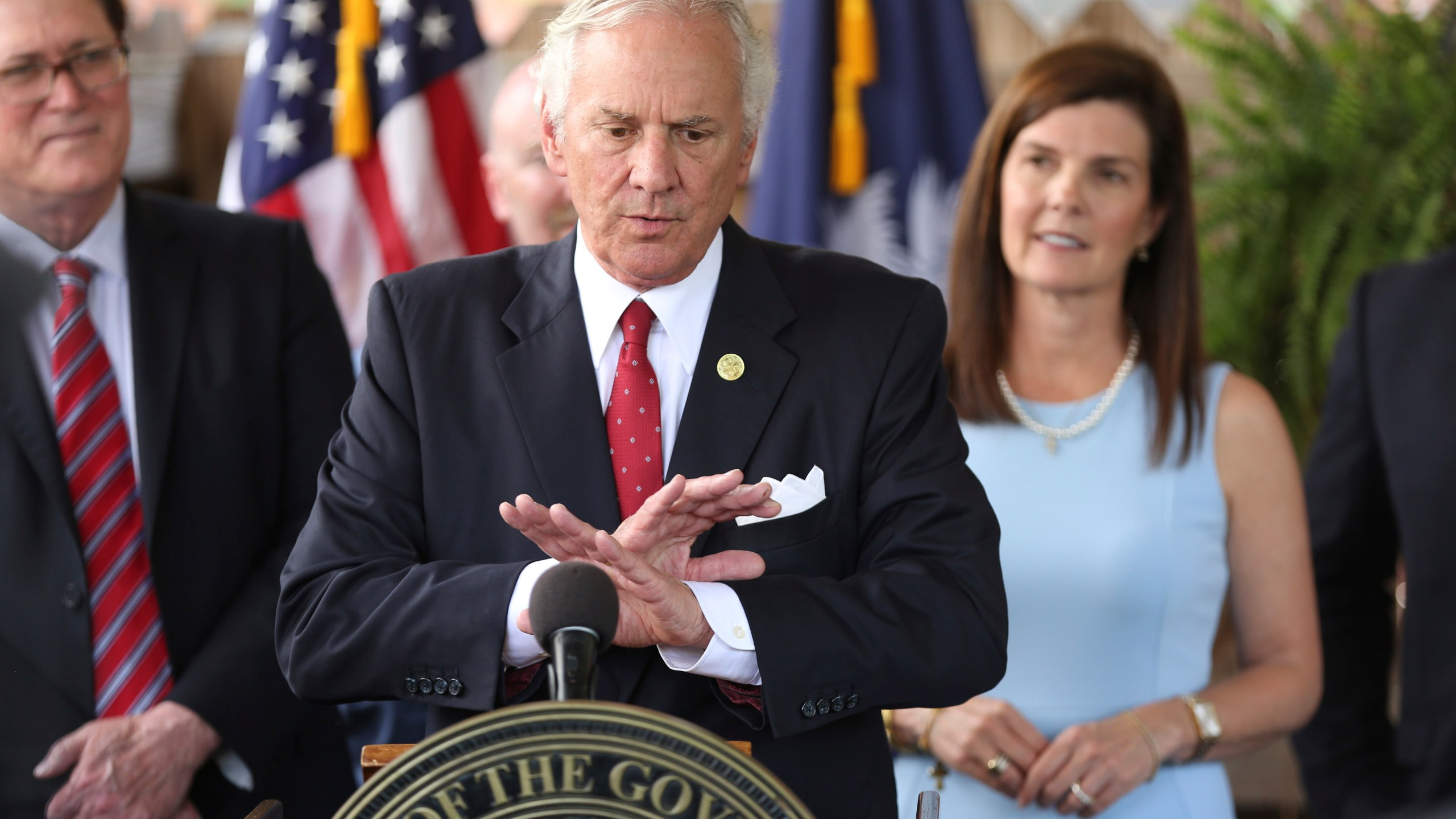In this June 24, 2021, file photo, South Carolina Gov. Henry McMaster speaks during a ceremony to sign a bill preventing people from suing businesses over COVID-19 on Thursday, at Cafe Strudel in West Columbia, S.C. McMaster is one of several Republican state leaders opposing federal efforts to go door-to-door to urge people to get vaccinated against COVID-19. (AP Photo/Jeffrey Collins, File)