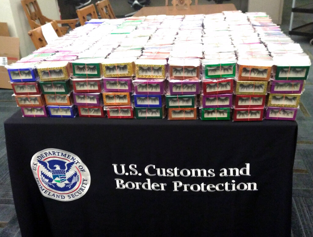 This photo provided by U.S. Customs and Border Protection shows boxes of long lashes seized Tuesday, July 6, 2021 at Louis Armstrong New Orleans International Airport. (U.S. Customs and Border Protection via AP)
